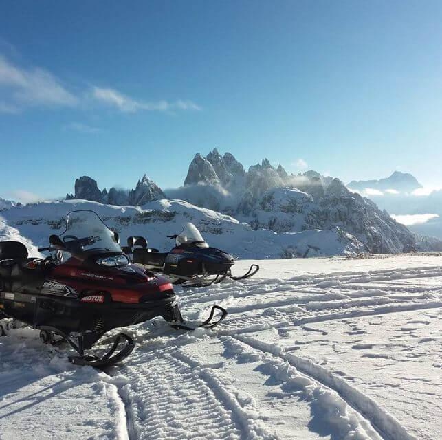 Ontdek de Dolomieten per sneeuwscooter met Get Your Guide